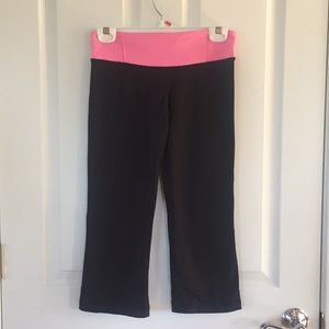 Lululemon black crops with pink waist band